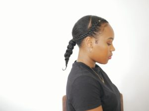 low ponytail with braids on medium length natural hair protective style